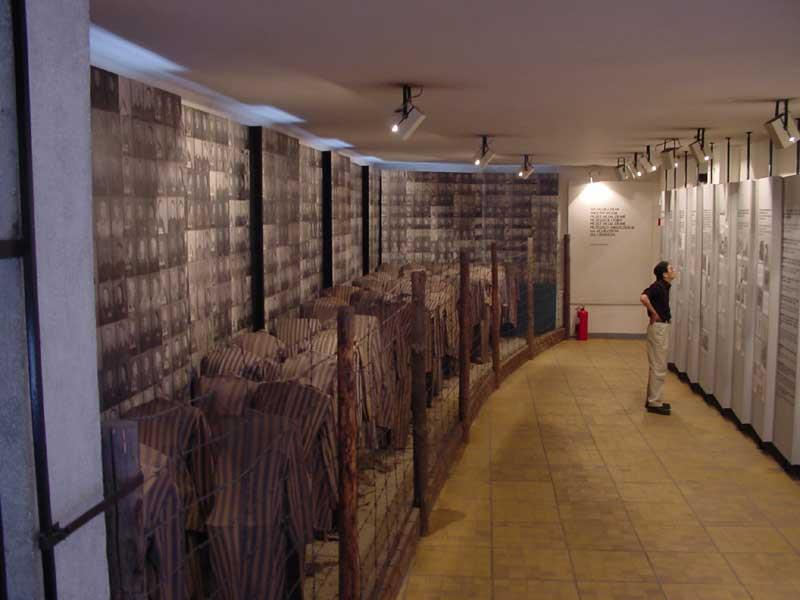 This was a very disturbing exhibit, what you see on the left is a line of uniforms marching off to the death camps with a wall of pictures of the poople who died here.  The uniforms are authintic.