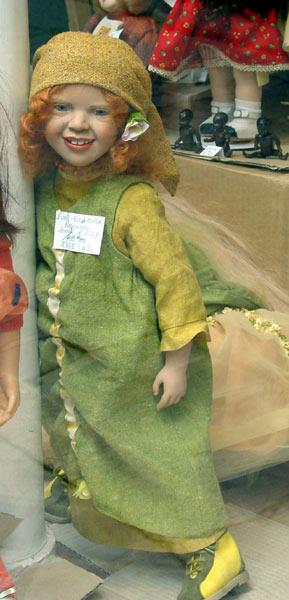 Saw this doll in the window and liked her.  She has red hair and blue eyes. . .