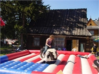 The stars and stripes show up in Poland in the form of a bull ride.